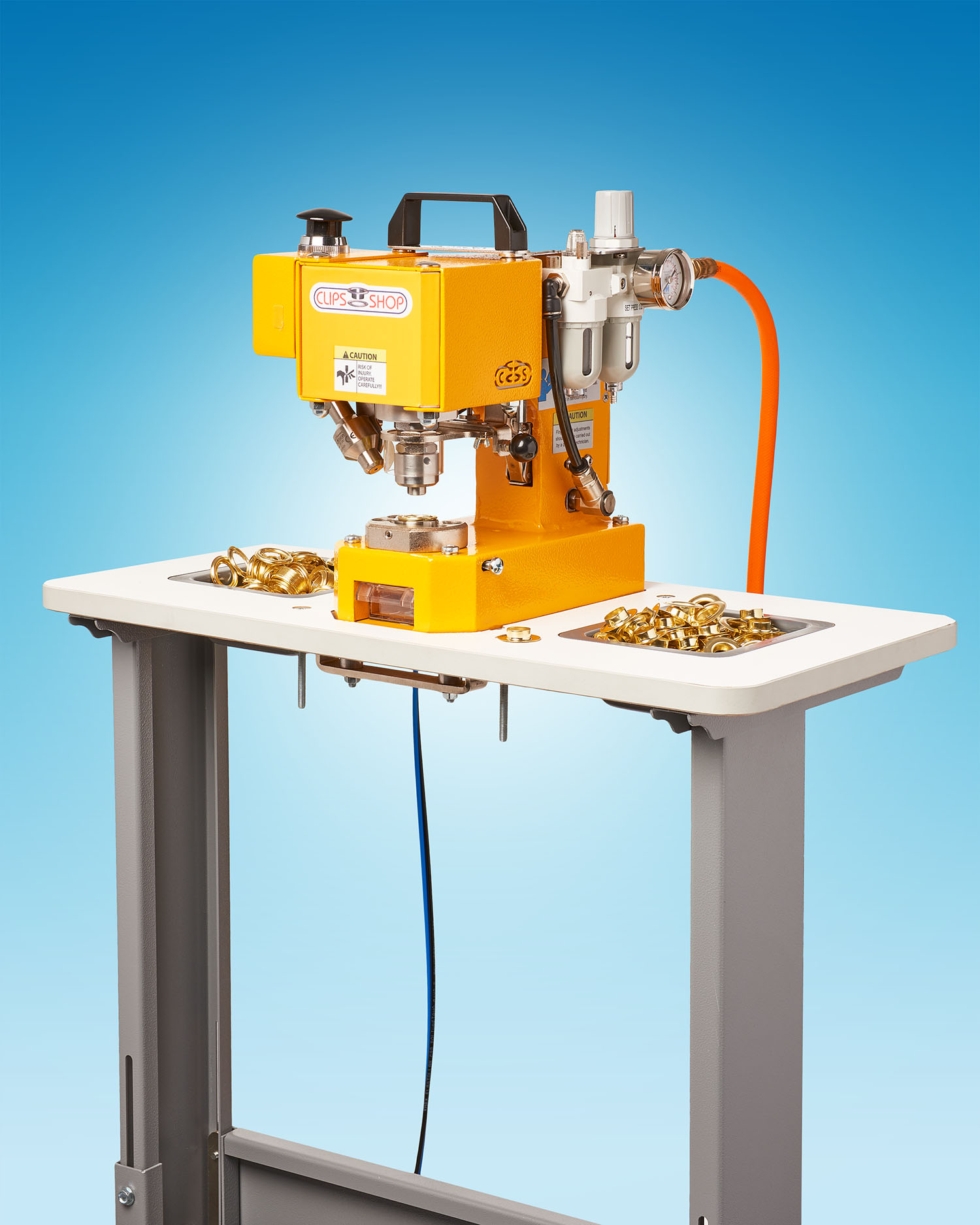 PORTABLE PNEUMATIC GROMMET ATTACHING MACHINE GETS A NEW ADJUSTABLE WORK TABLE